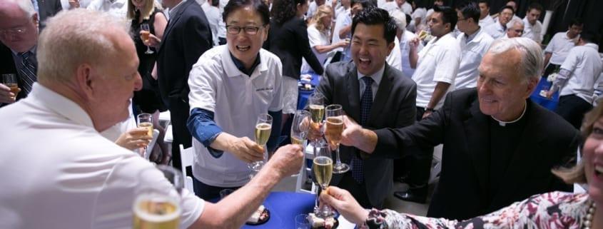Champagne Toast at Cake Cutting Celebration Samsung-Dacor Merger
